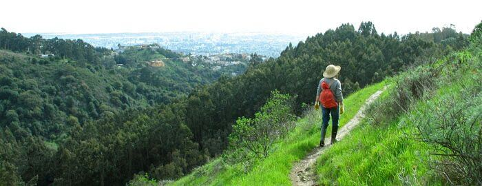 hiker-with-red-backpack-on-side-hill-trail